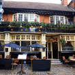 Classic English pub and european street cafe — Stock Photo #9504050