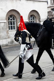 Royal horse guardsman with horse — Stock Photo