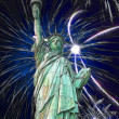 Statue of Liberty and fireworks in black sky — Stock Photo