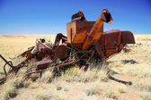 Vintage rusty abandoned combine harvester in old field, Arizona, — Stock Photo