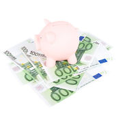 Hundred euro banknotes and coinbank — Stock Photo
