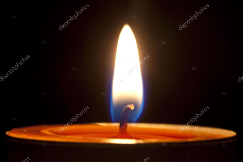 Candle fire on a black background. — Stock Photo #8867423