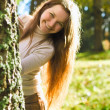 Stock Photo: Girl in Autumn Forest