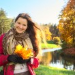 Girl with Bunch of Leaves — Stock Photo