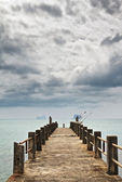 Pier under Dark Clouds — 图库照片