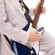 Royalty-Free Stock Photo: Man in white suit playing guitar