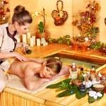 Woman getting stone therapy massage . — Stock Photo