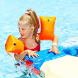 Child with armbands in swimming pool — Foto Stock