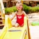 Child on water slide at aquapark. — Stock Photo