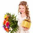 Child with spring flower and gift box. — Stock Photo