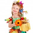 Child with butterfly holding gift box. — Stock Photo