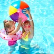 Child playing with ball in swimming pool. — Stock Photo #10519123