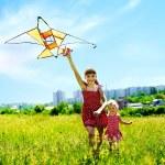 Group children flying kite outdoor. — Stock Photo