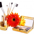 Decorative cosmetics and flower. — Stock Photo #10519367