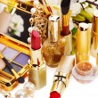 Decorative cosmetics and flower. — Stock Photo #10519370