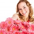 Happy young woman holding flowers. — Stock Photo