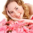 Young woman lying on flowers. — Stock Photo
