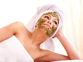 Woman getting facial mask in spa . — Stock Photo