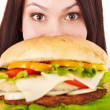 Woman holding hamburger. — Stock Photo #10526718