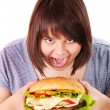 Woman eating hamburger. — Stock Photo #10526721