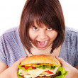 Stock Photo: Woman eating hamburger.