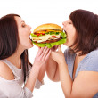Women eating hamburger. — Stock Photo