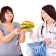 Woman with hamburger and doctor. — Stock Photo #10526727