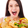 Thin woman holding hamburger. — Stock Photo