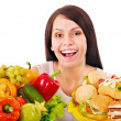 Woman choosing between fruit and hamburger. — Stok fotoğraf