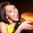 Woman eating hamburger. — Stock Photo #10526812