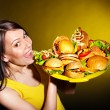 Stock Photo: Thin womholding hamburger.