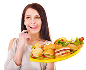Thin woman holding hamburger. — Stock Photo