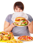 Woman refusing fast food. — Stock Photo