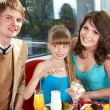 Stock Photo: Happy family with child in cafe.