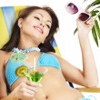 Girl in bikini drinking orange juice. — Stock Photo