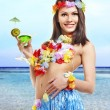 Woman in hawaii costume drink  juice. - Stock Photo