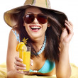 Woman on beach drinking cocktail. — Stock Photo #10540481