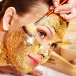 Woman getting facial mask . — Стоковое фото #10540718