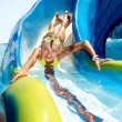 Постер, плакат: Child on water slide at aquapark