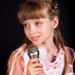 Singing of child in microphone. — Stock Photo