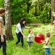 Outdoor happy family plaing ball . — Stock Photo #10541230
