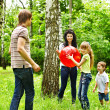 Outdoor happy family playing ball . — Stock Photo #10541233