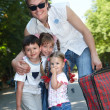 Stock Photo: Father and group children in park with case.
