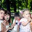 Happy family in park with  bubbles. — Foto Stock