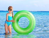 Children holding inflatable ring in sea. — Foto Stock