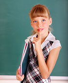 Schoolchild near green blackboard. — Stock Photo