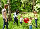 Outdoor happy family plaing ball . — Stock Photo