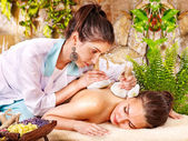 Woman getting herbal compress massage. — Stock Photo