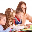 Kindergarden teacher with children. — Stock Photo #8605071