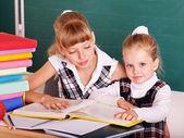 Schoolchildren in classroom near blackboard. — Stock Photo